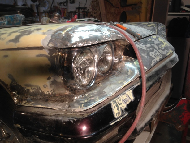 Fender tucked around the Caddy headlight bezel.